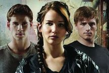 The Hunger Games Fandom -Shipping   / Love and relationships in The Hunger Games is a largely dominant factor and is what creates fandom and the idea of shipping. The love triad or love-triangle between Katniss, Peeta, and Gale allows for emotional involvement by fans as its not only tied to the story anymore but the characters themselves.