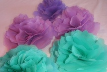 Fabric flowers, bows and pom-poms.