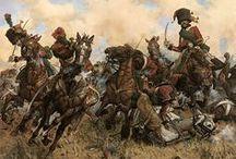 Caballería / Se conoce como caballería al cuerpo perteneciente al ejército de una nación que se encuentra conformado por soldados montados a caballo, es decir, es la fuerza de combate montada a caballo. Desde tiempos inmemoriales, los seres humanos, han empleado a los caballos a instancias de los combates, o sea, con un fin estrictamente militar.