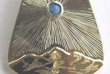 Custom Pendants / Hand made Custom Pendants in gold, silver and platinum with semi-precious and precious stones.