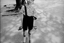 "Diane Arbus / Diane Arbus (1923-1971) Famous For: Being the ""photographer of freaks"" Diane Arbus's photographs bordered between reality and the surreal. Her subjects included circus people, dwarfs, giants, and nudists."