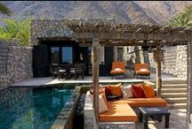 Six Senses Zighy Bay / Six Senses Zighy Bay is located on Oman's Musandam Peninsula. The setting of the 82 indigenous village-style pool villas is spectacular, with dramatic mountains and a sandy beach.