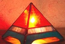 5 Elements - Fire / Fire Element: red (orange, yellows), candles, lights, pets and wildlife, things made from animals: leather, fur, feather, bone, wool etc, art depicting: people,  animals, sun, sunlight, triangle shape