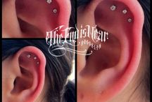 Precision Body Piercing / Located just a few blocks from our sister studio, Hand of Glory Tattoo, The End Is Near offers precision body piercing, custom tattooing, one-of-a-kind jewelry, and fine art.  Professional Body Piercing by Adam P. Block and guests available 7 days a week.