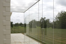Project: Edge House / A frameless glass link between to aspects of this large, listed residential house