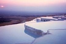 "Pamukkale / Pamukkale, which literally means ""cotton castle"", is the name the Turks gave to the extraordinary site of Hierapolis. This site is exceptional by vurtue of its superlative natural phenomena - warm, heavily mineralized water flowing from springs creating pools and terraces which are visually stunning..."