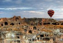 """Cappadocia / Once I asked to a fiend to describe Cappadocia, and she told me: """"Cappadocia is a city, like Istanbul… But instead of the buildings, there are vertical and huge rocks of extravagant forms in which people excavated their own house… And it seems to be on the moon."""""""