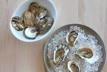 Oyster Feast / The season approaches— here's everything you need to celebrate with a chic oyster feast. Show them off on Terrafirma platters, pair them with a glass of something special, and discover the secret oyster paradise on the Gulf Coast shore, where the oystermen still pluck their quarry from the sea with tongs.