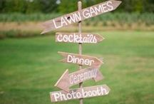 "wedding signage / ""This way to the I do's,"" ""Alex + Meredith,"" ""This way,"" ""Almost there,"" ""Lawn Games..."""