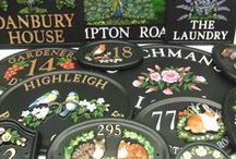 Personalised Hand Painted house signs / Showing raised designs on our personalised house signs, which are all hand painted and produced in our workshop at Watford in the UK.
