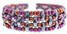 The Cali Bead / Cali® is a 3-hole bead made of Czech glass measuring 3x8 mm. It is available in over 50 colors and special effects. This new bead will showcase seed beads spectacularly, which are the staple of designer pieces that illustrate bead-weaving techniques. Cali® is curved on both sides boasting a double convex surface. This bead was designed by beading expert Patty McCourt. She named this bead after her hometown in Colombia.
