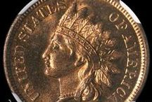 Indian Head Cents (1900-1909) / James Barton Longacre designed the Indian Head Cent in 1859. The coin had the representation of Liberty wearing an Indian headdress on the obverse, and a laurel wreath on the reverse along with the inscription ONE CENT.