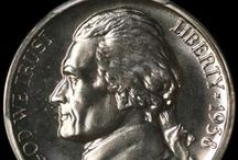 Jefferson Nickels (1938-1942 Type 1)  / The Jefferson Nickel was designed by Felix Schlag, whose creative design displaying the portrait of Thomas Jefferson on the obverse and a corner view of Jefferson's home, Monticello, on the reverse won him an award of $1,000. The new nickels were first issued in 1938 and showed president Jefferson's bust facing left on the obverse and the front view of Monticello on the reverse.  / by Executive Coin