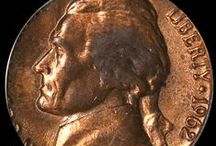 Jefferson Nickels (1956-1964) / The Jefferson Nickel was designed by Felix Schlag, whose creative design displaying the portrait of Thomas Jefferson on the obverse and a corner view of Jefferson's home, Monticello, on the reverse won him an award of $1,000. The new nickels were first issued in 1938 and showed president Jefferson's bust facing left on the obverse and the front view of Monticello on the reverse.  / by Executive Coin