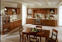PANERA - Traditional design / Panera recreates the warm and cozy atmosphere of the old times kitchens, through the solid alder wood, walnut stained, the wide counters intentionally made to receive friends and to cook in freedom.
