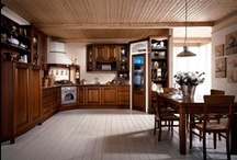 ETRUSCA - Traditional design / In bass wood.  Etrusca model masterly plays the kitchen-leaving area with a wise dosage of walls and volumes thanks to huge number of forms, practical accessories and efficient storage compartments, which joins the daily beauty use to the lovely finishes of the bass wood.