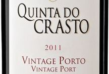 """ENJOY OUR VINTAGE PORT / The grapes used to make our Vintage Ports come from our best old vines. They are then foot trodden in old stone tanks called """"lagares"""".  Our Vintage Ports are bottled unfiltered after maturing for two years in large Portuguese oak vats. When young they are usually a very dark ruby in colour almost opaque with intense aromas of very ripe fruit. Combining in highly complex wines that have great longevity."""