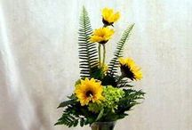 Our Sunny Arrangements / Our bright, cheerful arrangements featuring sunflowers.