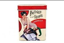 """Pin Up / Leone's candy originals in """"cult"""" tins and boxes with """"pop"""" illustration by Renato Sorrentino. To celebrate """"Italianity"""" made of affidability, loveliness, passion, creativity and sweetness, of course!"""