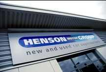 Henson Motor Group —NWD / Successful car dealers Henson Motor Group approached us to refresh their showroom interior and update their brand which was reflected in their signage, flags and on car signage.