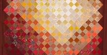 Colour Graduation Ideas for Quilts / Quilts that exhibit gradual colour change over the surface. These quilts are beautiful in themselves, but also color graduations or color transitions make great backgrounds for another feature such as applique. Start your next quilt design here!