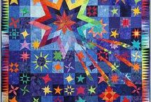 Star Quilt Ideas / Quilts with star motifs. Includes Mariner's Compass quilts. Find inspiration for your next star quilt here.