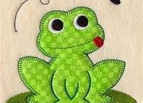 Frogs on Quilts and Pillows / Quilted items bearing pictures and depictions of frogs. Pillows, cushions, quilts, wall hangings, all with frogs on.