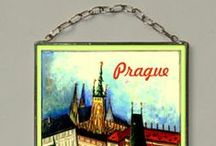Prague, Stained Glass / Motive was inspired by Art Nouveau age in 19th century. The closeness of the copy is gained due to digital typewriter. The print is protected by two pieces of 1,3 mm thick glass that are embedded into the thin lead section and soldered by tin. We use special UV stabilized paints. This window-pane is suitable for windows or to hang on a wall like a picture. The window-pane is provided in a three-layer pasteboard made specifically for this product.