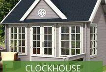 """Clockhouse Gartenhäuser / Clockhouse-Design: Gartenhäuser mit dem gewissen Etwas. """"Clockhouses"""" (zu deutsch:  """"Uhrenhäuser"""") sind Gartenhäuser,  deren Bauform eine Besonderheit aufweist: Über dem doppeltürigen Eingang faltet sich das Dach zu einem attraktiven Ziergiebel auf, der zur Anbringung einer großen Uhr genutzt werden kann, aber nicht muss."""