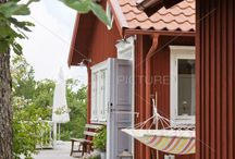 Red cottage with white house corners / Swedish traditional wooden house