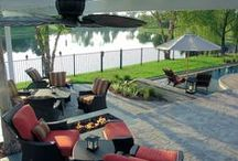 Backyard Oasis Design / This home offers one of the most beautiful backyards in Jacksonville, FL. 5 Star Outdoor Design custom built this zero edge pool with two sun shelves. The fire pit was built in a perfect spot so that it could be enjoyed from the lower or upper patio areas and the pergola was carefully built around an existing tree in the backyard. All of that plus the amazing views of the lake make this outdoor space truly unique.