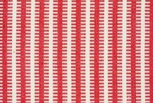 Soane Fabric - Raspberry Reds / Soane's collection of plain and patterned fabrics are woven and printed exclusively in British mills and workshops.   Our expert makers employ traditional methods, such as block and screen printing, perfected over generations, to create fine quality fabrics with the timeless appeal and atmosphere of old textiles.