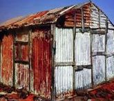 """Bairro da Lata /   Favelas, shanty towns, slums, bairro da lata....  At the margins of human society, those who 'have not', cry for the right to be able to be alive.  """"I want to live"""" is written on the walls.   Nonetheless, much of this architecture has a great beauty of it`s own...."""
