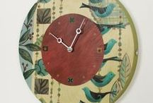 Wall Clocks / Our handcrafted wall clock is created using various painting and collage techniques. The edge of each piece is hand painted in a combed texture in a beautiful, complimentary color. Each clock is signed, dated and hallmarked with a cast pewter charm. All clocks are outfitted with Seiko clock mechanisms and use a standard AA battery.