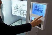Expotronik / Expotronik es una máquina expositora y expendedora de arte que se constituye en un eficaz dispositivo expositor y dispensador de arte: dibujos, fotografías, bocetos, incluso textos o proyectos. Acoge obras realizadas sobre papel, fundamentalmente. Funciona como un dispositivo de arte móvil, portátil. Como una galería de arte portátil.
