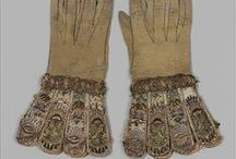 Gloves with embroidered gauntlets (MMA 28.220.7, .8) / Pair of gloves Date: ca. 1600 Culture: British Medium: Leather, satin worked with silk and metal thread, seed pearls; satin, couching, and darning stitches; metal bobbin lace; paper Dimensions: L. 12 1/4 x W. 6 1/4 inches (31.1 x 15.9 cm) Classification: Textiles-Embroidered Credit Line: Gift of Mrs. Edward S. Harkness, 1928 Accession Number: 28.220.7, .8