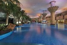 Club Oasis, Grand Hyatt Beijing / A visual treat, Club Oasisfeatures a magnificent resort-style indoor swimming pool nestled amongst lush tropical vegetation, waterfalls, stone status, majestic pillars, grottos and palm trees that are reflected in the shimmering 1,500-sq-m sapphire pool. Chirp of birds and frogs through the sound system immerses you in another world. Enjoy a dip or a swim and complete with a refreshing drink at the poolside for the relaxing time.        / by Grand Hyatt Beijing At Oriental Plaza