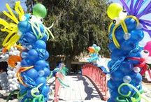 """Balloon Art & Decor / We have one of the largest latex and foil balloon selections in DFW. Everything from 5"""" - 60"""" latex rounds, animal twisting balloons, themed foils to jumbo 6"""" tall foil balloon flowers. Everything you need under one roof."""