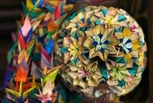 """ORIGAMI / Origami: from ori meaning """"folding"""", and kami meaning """"paper"""" is the traditional Japanese art of paper folding, which started in the 17th century AD and was popularized outside of Japan in the mid-1900s. It has since evolved into a modern art form. The goal of this art is to transform a flat sheet of paper into a finished sculpture through folding and sculpting techniques."""