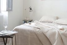 b e d r o o m / Bedroom inspiration: cozy knitted blankets, plain white walls, wooden floors and faux fur rugs