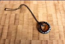 Necklaces / Upcycled glass is made into beautifully unique pendants that you can show off and wear around your neck.