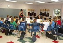 """Band / Upper School students """"strike up the band"""" with formal instruction on instruments. Fifth grade students choose an instrument and learn the basics of performing in a Beginning Band. Students perform two concerts while learning scales, passing off of songs, and playing as an ensemble. Sixth Grade students have the opportunity to be part of the Wood Acres Concert Band while Seventh and Eigth graders make up our Advanced Concert Band."""