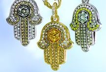 """Hamsa pendants / The hamsa hand (Arabic) or hamesh hand (Hebrew) is an old and still popular apotropaic amulet for magical protection from the envious or evil eye. The words hamsa and hamesh mean """"five"""" and refer to the digits on the hand."""