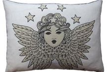 Vintage Tattoo & Seaside Collection ❤️ / Inspired by the body art favoured by seamen and circus artists between the two World Wars.  Made from natural linen and appliquéd with hand-embroidery, these striking cushions, purses and lavender bags are adorned with traditional tattoo imagery such as hearts, anchors, birds, stars and text banners.
