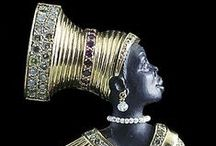 Jewelry: Blackamoor / Blackamoor jewelry is believed to have originated in the mid-17th century in Venice, Italy. Blackamoor/Moretti (Italian: moors head) figures are depictions of dark-skinned Africans. The blackamoor is typically male, depicted with a head covering, usually a turban, and covered in rich jewels and gold leaf. Venetian jewelry designer Giulio Nardi, who first began producing blackamoors in the early twenties, is known as a master craftsman of them.