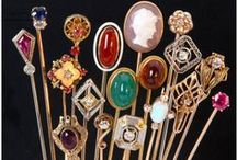 """Jewelry: Hatpin/StickPin/Jabot / HATPIN: A decorative/functional 6""""-12"""" pin with a decorated pinhead for holding a hat to the head, usually by the hair.   STICK/TIE PIN: A pin, under 6"""" long, with an ornament on the top worn vertically on a scarf or lapel. JABOT/SURETE PIN: A jabot is a ruffle worn on the bosom of a man's shirt or woman's blouse. It is basically a pin with a brooch at either end. One brooch is removable so that the pin can be stuck through the garment and then secured by reattaching the removable brooch."""