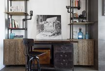 PHOTO LOFT / The interior of a photographer's loft was completely demolished and rebuilt. Custom shelving and displays were designed to display the client's antique camera collection and books on photography. The client had requested to use reclaimed wood materials and simple, metal elements. A custom, low, bed was designed on a small black platform to give the sense that the bed is floating slightly above the floor. A bright new kitchen and bathroom add modern touches to the loft.