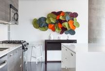 LOFT 002 / A subtle earth-toned colour palette is punctuated by splashes of vibrant colour by Golbou Rad of Rad Design Inc for a brightly lit loft located in Toronto's trendy King West Area.  The 1100 square feet loft features an open kitchen, large living area, 2 bedrooms and 2 bathrooms, organized along a large window wall that runs the length of the apartment.