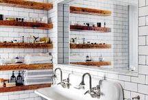 Bathrooms / Sinks.  Bathroom tile.  Showers.  Bathroom rugs.  Art in the bathroom.  Sconces.  Bathroom lighting.  Bathroom fixtures.  Bathroom design.  Bathroom style.  Tubs.  Faucets.  Towels.  Towel bars.  Towel hooks.  Bathroom shelving.  Bathroom shelves.  Bathroom storage.  Linens.  White bathrooms.  Colorful bathrooms.  Serene bathrooms.  Energizing bathrooms.  Small bathrooms.  Showers.  Shower curtains.  Bathroom windows.  His and Hers.