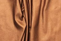 Faux Vegan Leather Fabrics / Vegan Leather Fabric - A poly spandex blend faux leather fabric with a textured, small pebble matte surface on the front and a soft spandex knit backing. Available in a stretch and non-stretch, perfect for apparel, accessories, baby moccasins, bags, and more!